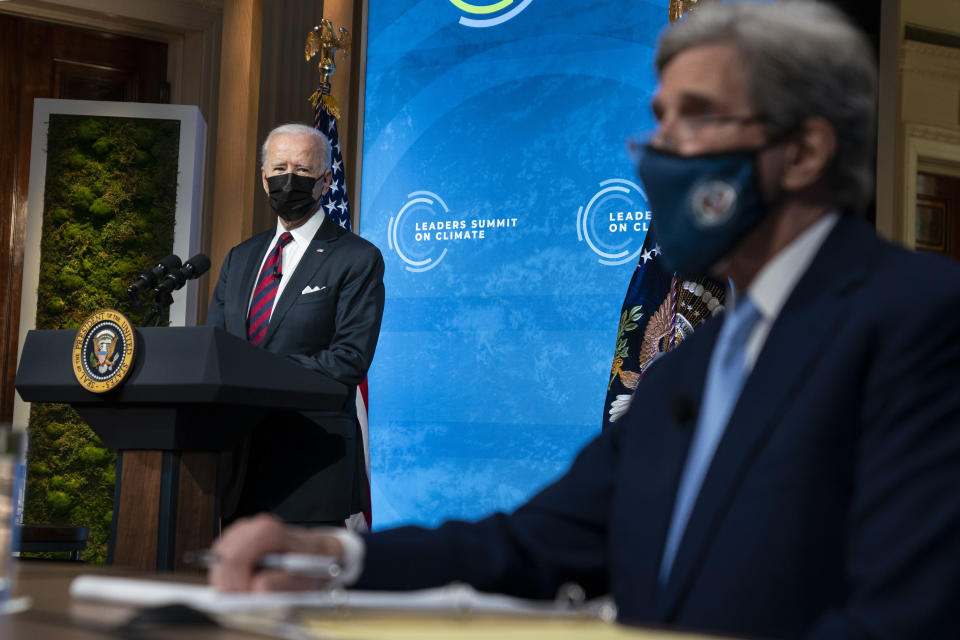 President Joe Biden and Special Presidential Envoy for Climate John Kerry listen during the virtual Leaders Summit on Climate, from the East Room of the White House, Thursday, April 22, 2021, in Washington. (AP Photo/Evan Vucci)