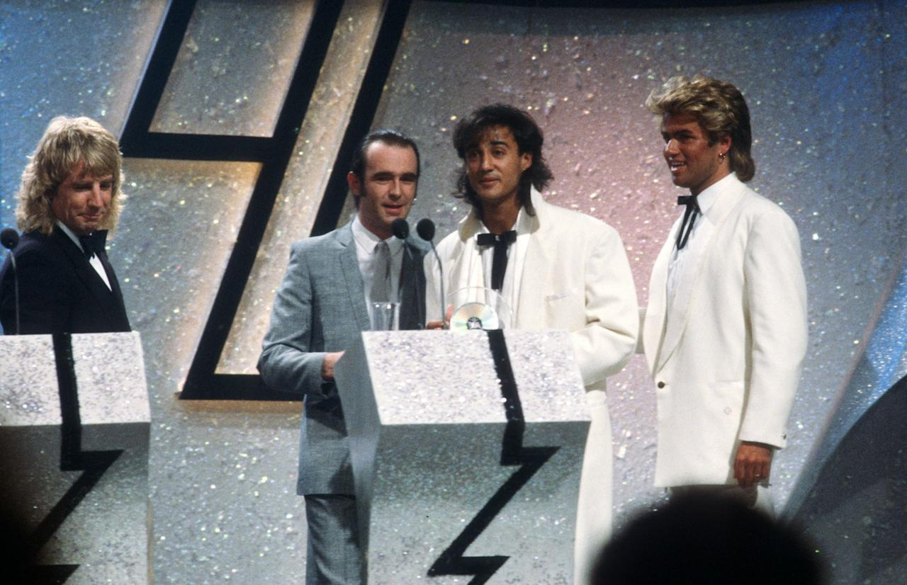 <p>Rick Parfitt and Francis Rossi present Andrew Ridgeley and George Michael Best British Group. (WENN) </p>