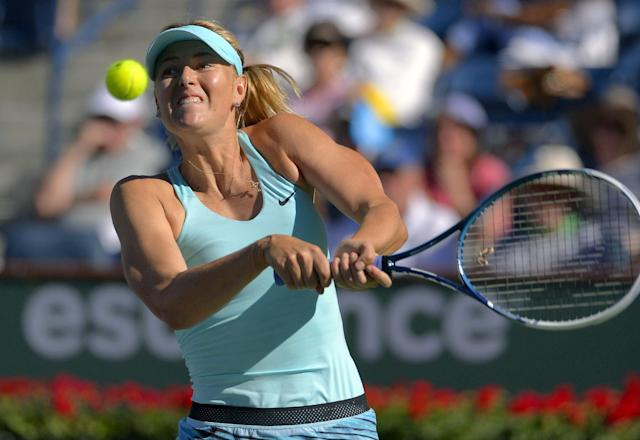 Maria Sharapova, of Russia, hits to Camila Giorgi, of Italy, during a third round match at the BNP Paribas Open tennis tournament, Monday, March 10, 2014, in Indian Wells, Calif. (AP Photo/Mark J. Terrill)