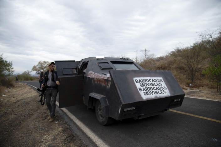 """The Spanish message """"Mobile barricade"""" covers the front of a homemade tank known as a """"monster"""" during patrols by a female-led, self-defense group along the edge of El Terrero, where it shares a border with the town of Aguililla, in Michoacan state, Mexico, Thursday, Jan. 14, 2021. The rural area is traversed by dirt roads, through which they fear Jalisco gunmen could penetrate at a time when the homicide rate in Michoacán has spiked to levels not seen since 2013. (AP Photo/Armando Solis)"""