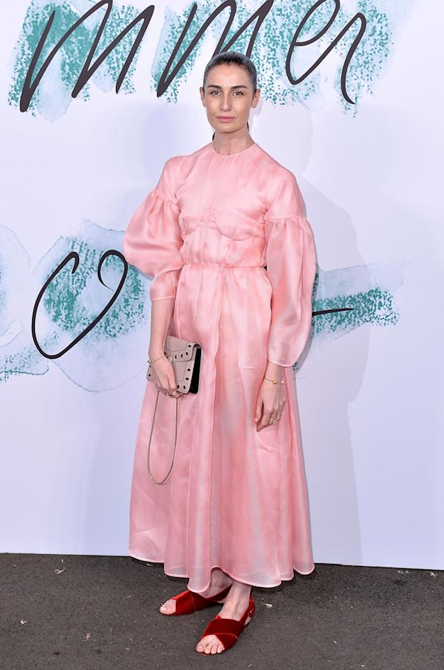 <p>The statuesque model looked as elegant as ever in a puffy pink gown and velvet sandals.<br /><i>[Photo: Getty]</i> </p>