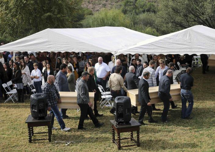 Men carry the remains of Dawna Ray Langford, 43, and her sons Trevor, 11, and Rogan, 2, who were killed by drug cartel gunmen, before their burial at the cemetery in La Mora, Sonora state, Mexico, Thursday, Nov. 7, 2019. Three women and six of their children, all members of the extended LeBaron family, died when they were gunned down in an attack while traveling along Mexico's Chihuahua and Sonora state border on Monday. (AP Photo/Marco Ugarte)