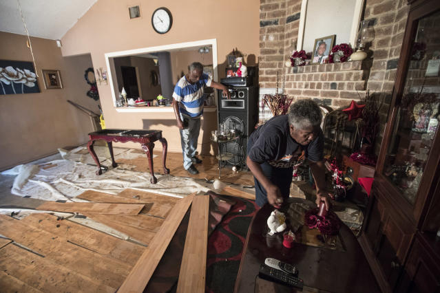 <p>Willie Johnson, left, and his wife Loicy, clean up their flood-damaged home in the aftermath of Tropical Storm Harvey in the Verde Forest subdivision of Houston on Thursday, Aug. 31, 2017. (Photo: Brett Coomer/Houston Chronicle via AP) </p>