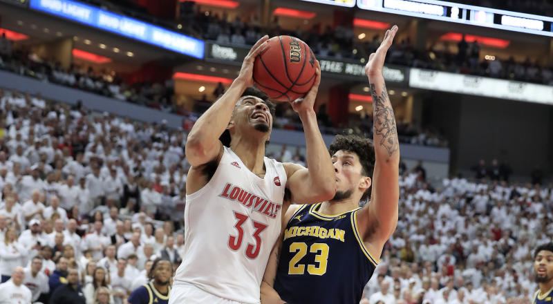 LOUISVILLE, KENTUCKY - DECEMBER 03: Jordan Nwora #33 of the Louisville Cardinals shoots the ball during the 58-43 win against the Michigan Wolverines at KFC YUM! Center on December 03, 2019 in Louisville, Kentucky. (Photo by Andy Lyons/Getty Images)