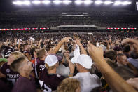 Fans celebrate after Texas A&M upset Alabama in an NCAA college football game Saturday, Oct. 9, 2021, in College Station, Texas. (AP Photo/Sam Craft)