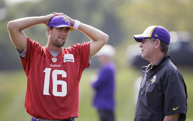 FILE - In this Aug. 1, 2014, file photo, Minnesota Vikings quarterback Matt Cassel, left, talks with offensive coordinator Norv Turner during an NFL football training camp practice in Mankato, Minn. The Minnesota Vikings made the safe pick of the starting quarterback with Cassel. Players have given raving reviews of offensive coordinator Norv Turner's system, and if healthy the Vikings ought to score plenty of points.(AP Photo/Charlie Neibergall, File)