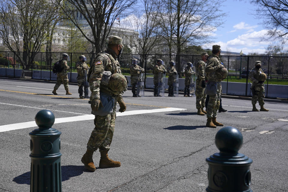 Troops stand guard near the scene of a car that crashed into a barrier on Capitol Hill in Washington, Friday, April 2, 2021. (AP Photo/Patrick Semansky)