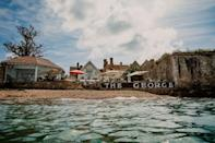 """<p>Couples will fall head over heels for this boutique UK beach hotel, with picturesque views and even better food (three AA red stars and two rosettes, thank you very much).</p><p>The grand 17th century townhouse has an upmarket but relaxed feel, and is nestled right on the water's edge at Yarmouth. Do stroll into town to discover the independent shops for unusual gifts.</p><p><a href=""""https://www.goodhousekeepingholidays.com/offers/isle-of-wight-george-hotel"""" rel=""""nofollow noopener"""" target=""""_blank"""" data-ylk=""""slk:Read our review of The George Hotel."""" class=""""link rapid-noclick-resp"""">Read our review of The George Hotel.</a></p><p><a class=""""link rapid-noclick-resp"""" href=""""https://go.redirectingat.com?id=127X1599956&url=https%3A%2F%2Fwww.booking.com%2Fhotel%2Fgb%2Fthebestwesterngeorgehotel.en-gb.html%3Faid%3D1922306%26label%3Dbeach-hotels-uk&sref=https%3A%2F%2Fwww.goodhousekeeping.com%2Fuk%2Flifestyle%2Ftravel%2Fg34584524%2Fbeach-hotels-uk%2F"""" rel=""""nofollow noopener"""" target=""""_blank"""" data-ylk=""""slk:CHECK AVAILABILITY"""">CHECK AVAILABILITY</a></p>"""