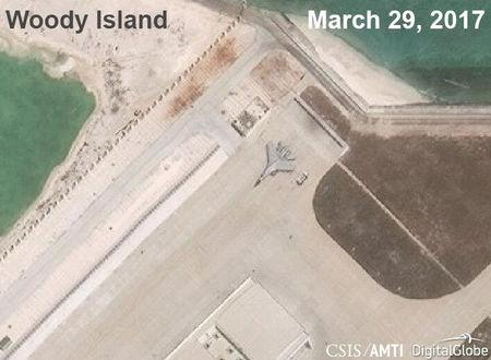 A Chinese J-11 fighter jet is pictured on the airstrip at Woody Island in the South China Sea in this handout satellite photo