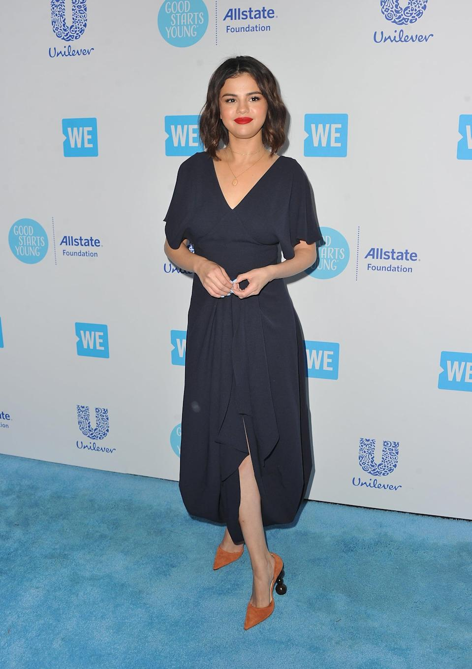 """<p><a href=""""https://www.popsugar.com/fashion/Selena-Gomez-Brown-Heels-We-Day-2018-44761525"""" class=""""link rapid-noclick-resp"""" rel=""""nofollow noopener"""" target=""""_blank"""" data-ylk=""""slk:Selena wore a total Jacquemus look"""">Selena wore a total Jacquemus look</a> to WE Day California in April 2018. Her wooden, marble-effect heels made a statement as she walked down the red carpet.</p>"""