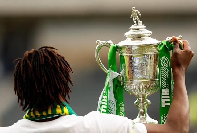 Soccer Football - Scottish Cup Final - Celtic vs Motherwell - Hampden Park, Glasgow, Britain - May 19, 2018 Celtic's Dedryck Boyata celebrates with the trophy after winning the Scottish Cup Action Images via Reuters/Jason Cairnduff
