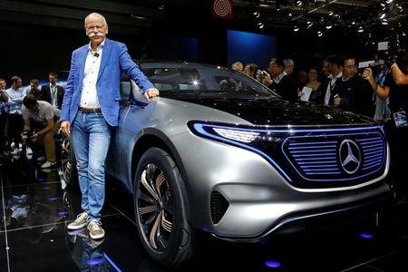 Dieter Zetsche, CEO of Daimler and Head of Mercedes-Benz, poses in front of a Mercedes EQ Electric car at the Mondial de l'Automobile, the Paris auto show, in Paris, France, September 29, 2016. REUTERS/Jacky Naegelen/File Photo