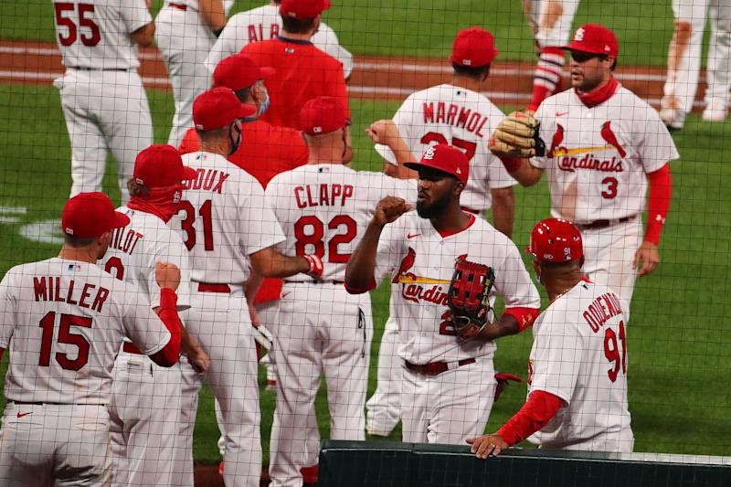 ST LOUIS, MO - AUGUST 24: Dexter Fowler #25 of the St. Louis Cardinals celebrates with his teammates after beating the Kansas City Royals at Busch Stadium on August 24, 2020 in St Louis, Missouri. (Photo by Dilip Vishwanat/Getty Images)