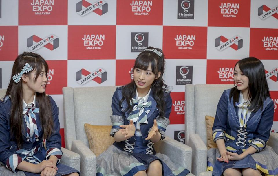 (From left) Rin Okabe, Yui Oguri, and Mion Mukaichi speak during a press conference in Kuala Lumpur. — Picture by Firdaus Latif
