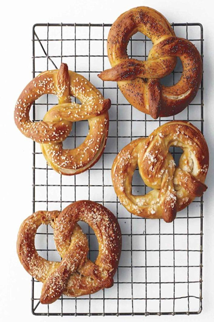 """<p>Forget about the bagged pretzels, and treat your guests to these salty soft pretzels instead.</p><p><em><a href=""""https://www.womansday.com/food-recipes/food-drinks/recipes/a11828/soft-pretzels-recipe/"""" rel=""""nofollow noopener"""" target=""""_blank"""" data-ylk=""""slk:Get the Soft Pretzels recipe"""" class=""""link rapid-noclick-resp"""">Get the Soft Pretzels recipe</a>.</em></p>"""