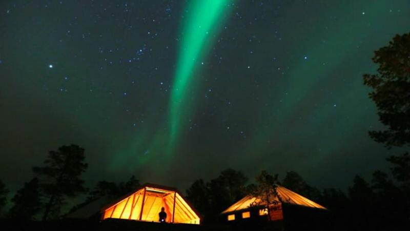 The Aurora Borealis (Northern Lights) is seen over a mountain camp north of the Arctic Circle. Image: Reuters