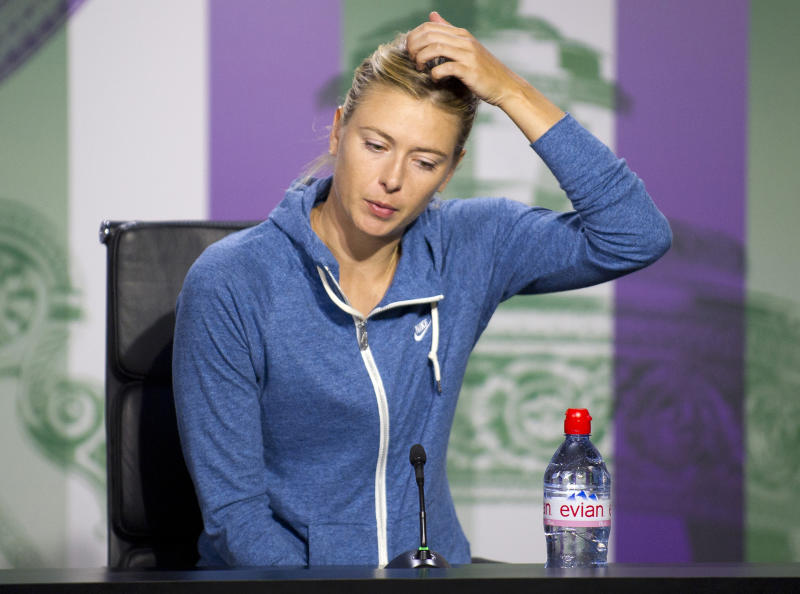 Maria Sharapova of Russia speaks during a news conference following her defeat in a Women's second round singles match to Michelle Larcher De Brito of Portugal at the All England Lawn Tennis Championships, Wimbledon, London, Wednesday, June 26, 2013. (AP Photo/AELTC, Chris Raphael)
