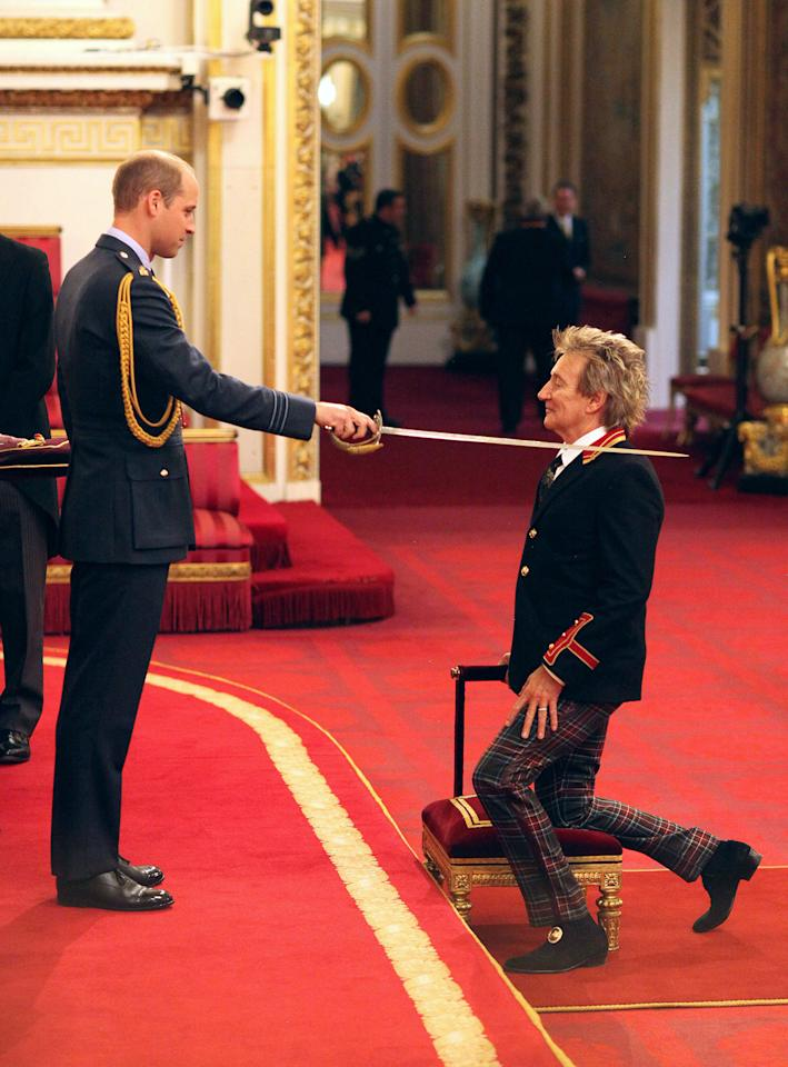<p>Veteran singer Sir Rod Stewart, right, is made a Knights Batchelor by Britain's William, the Duke of Cambridge, during an Investiture ceremony at Buckingham Palace in London, Tuesday Oct. 11, 2016. (Jonathan Brady/PA via AP) </p>