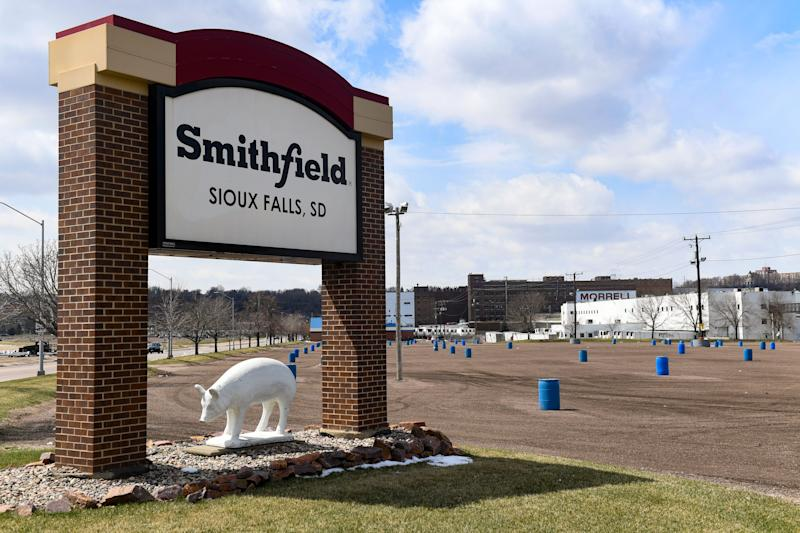 One of Smithfield Foods Inc. employee parking lots stands empty on April 15, in Sioux Falls, S.D. The plant, which is now closed indefinitely, is the nation's largest hot spot for the coronavirus after hundreds of employees tested positive.
