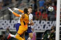 Jamaica goalkeeper Andre Blake (1) is unable to stop a header by United States forward Matthew Hoppe, center right, for a score as defender Oniel Fisher (8) looks on late in the second half of a CONCACAF Gold Cup quarterfinals soccer match, Sunday, July 25, 2021, in Arlington, Texas. (AP Photo/Brandon Wade)