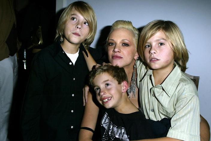 Asia Argento poses with a 7-year-old Jimmy Bennett, center, and co-stars Cole and Dylan Sprouse at a 2003 wrap party for their film, <i>The Heart Is Deceitful Above All Things</i>. (Photo: Jeff Vespa/WireImage)