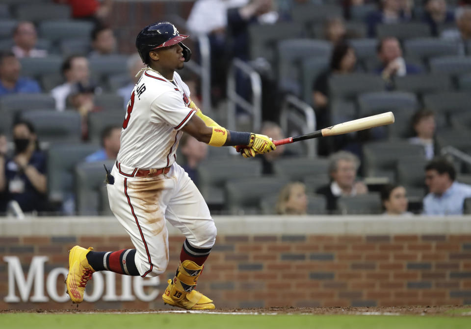 Atlanta Braves' Ronald Acuna Jr. swings for a home run off Toronto Blue Jays pitcher Robbie Ray in the third inning of a baseball game Tuesday, May 11, 2021, in Atlanta. (AP Photo/Ben Margot)