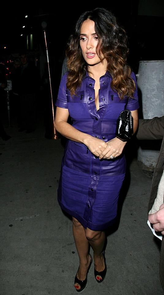 Salma Hayek rocked a rather snug and very low-cut purple leather dress on Tuesday when she had dinner at West Hollywood's hot Red O restaurant. (1/9/2012)