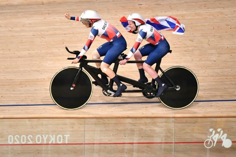 Britain's Lora Fachie and her pilot Corrine Hall celebrate victory in the women's B 3000m individual pursuit final. Fachie's husband Neil also won a cycling gold (AFP/Kazuhiro NOGI)