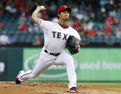 Texas Rangers starting pitcher Yu Darvish, of Japan, delivers to the Tampa Bay Rays in the first inning of a baseball game, Tuesday, Aug. 28, 2012, in Arlington, Texas. (AP Photo/Tony Gutierrez)