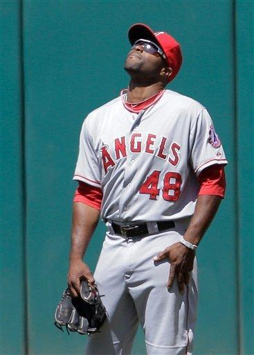 Los Angeles Angels right fielder Tori Hunter reacts after losing a fly ball in the sun by Cleveland Indians' Asdrubal Cabrera and not catching it for an error in the fifth inning of a baseball game in Cleveland, Sunday, April 29, 2012. Indians' Michael Brantley and Aaron Cunningham scored on the error. (AP Photo/Amy Sancetta)