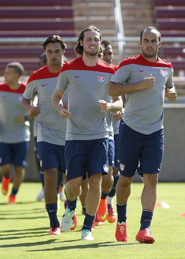 Landon Donovan, right, Mix Diskerud, center, and Chris Wondolowski warm up during a U.S. men's soccer team training session Wednesday, May 14, 2014, in Stanford, Calif. The team began a two-week training camp leading up to a May 27 exhibition with Azerbaijan at San Francisco's Candlestick Park. (AP Photo/Tony Avelar)
