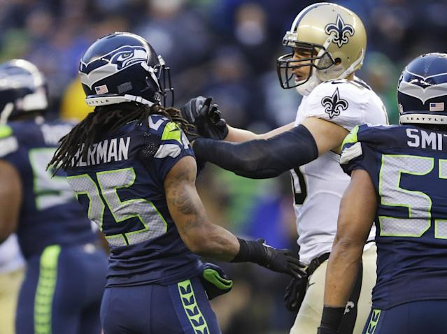 Seattle Seahawks cornerback Richard Sherman (25) and New Orleans Saints tight end Jimmy Graham (80) confront each other during the second half of an NFC divisional playoff NFL football game in Seattle, Saturday, Jan. 11, 2014. (AP Photo/Ted S. Warren)