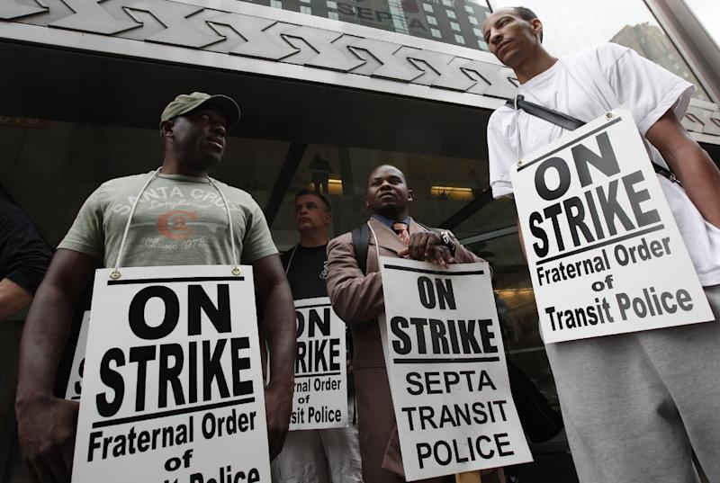 Striking Southeastern Pennsylvania Transportation Authority police officers picket outside the transit agency's offices Wednesday, March 21, 2012, in Philadelphia. (AP Photo/Matt Rourke)