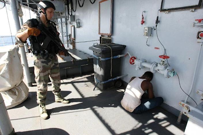 """A French soldier guards a suspected Somali pirate on board the French warship """"Le Nivose"""" in 2009 (AFP Photo/Pierre Verdy)"""