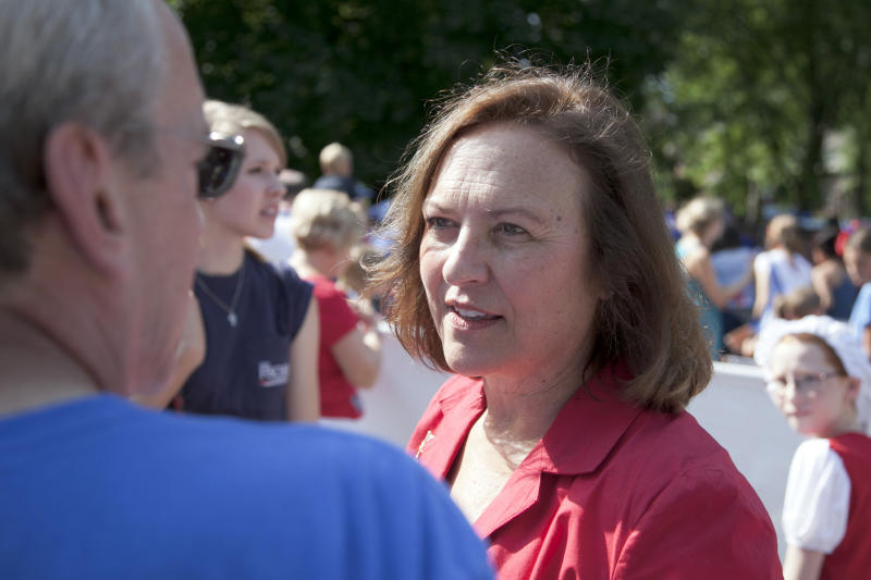 In this Wednesday, July 4, 2012 photo, Republican senate candidate, state Sen. Deb Fischer, center, campaigns at a July fourth parade in Omaha, Neb. Fischer is running against democrat Bob Kerrey for the senate seat vacated by Ben Nelson, D-Neb. Nebraska has far more cattle than people, so maybe it's not surprising that Republican U.S. Senate candidate Deb Fischer stresses her rural background, clearly betting that it will play well with voters who have become more conservative and suspicious of government since her opponent, Democrat Bob Kerrey left the Senate in January 2001. But Democrats have worked to find a downside to the ranching life, and their campaign attacks have made the Nebraska race unlike any other this election season.  (AP Photo/Nati Harnik)