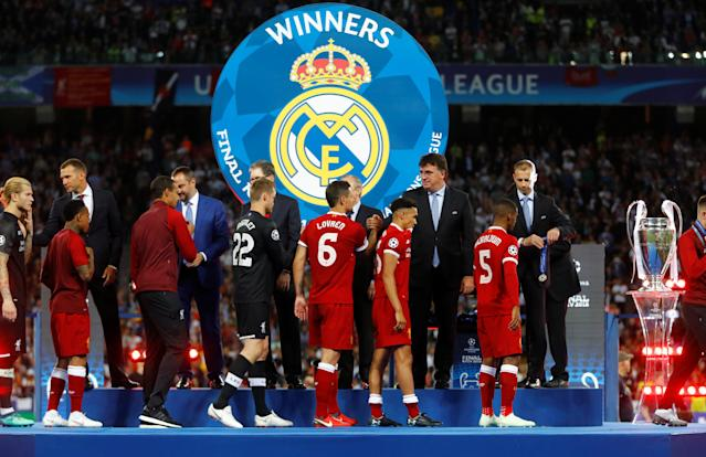 Soccer Football - Champions League Final - Real Madrid v Liverpool - NSC Olympic Stadium, Kiev, Ukraine - May 26, 2018 Liverpool's Dejan Lovren and team mates collect their medals as they react after the match REUTERS/Kai Pfaffenbach