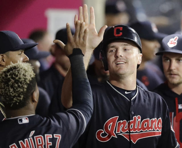 Cleveland Indians' Jay Bruce celebrates in the dugout after scoring on a single by Giovanny Urshela during the fourth inning of a baseball game against the Los Angeles Angels in Anaheim, Calif., Wednesday, Sept. 20, 2017. (AP Photo/Chris Carlson)