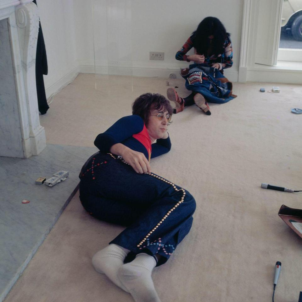 <p>John Lennon with his wife, Yoko Ono, at their home in Tittenhurst Park, near Ascot, Berkshire, July 1971.</p>