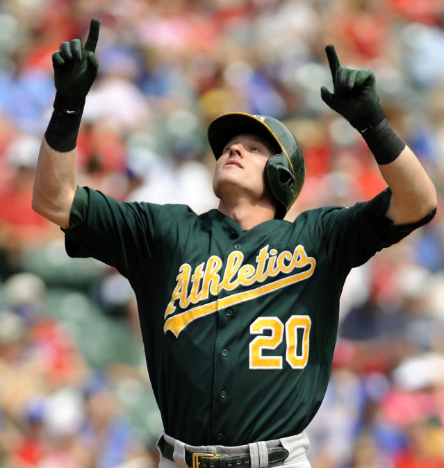 Oakland Athletics' Josh Donaldson (20) celebrates at home plate after hitting a home run off Texas Rangers starting pitcher Martin Perez in the first inning of a baseball game against the Texas Rangers, Sunday, Sept. 15, 2013, in Arlington, Texas. (AP Photo/Matt Strasen)