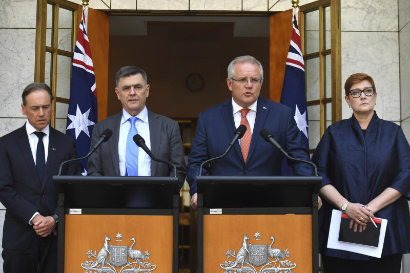 Australian Prime Minister Scott Morrison, second right, Minister for Health Greg Hunt, left, Chief Medical Officer Professor Brendan Murphy, and Minister for Foreign Affairs Marise Payne, right, give an update on the coronavirus at a press conference at Parliament House in Canberra, Wednesday, Jan. 29, 2020. Australia and New Zealand will work together to evacuate their isolated and vulnerable citizens from China's virus-hit Hubei province. (Mick Tsikas/AAP Image via AP)