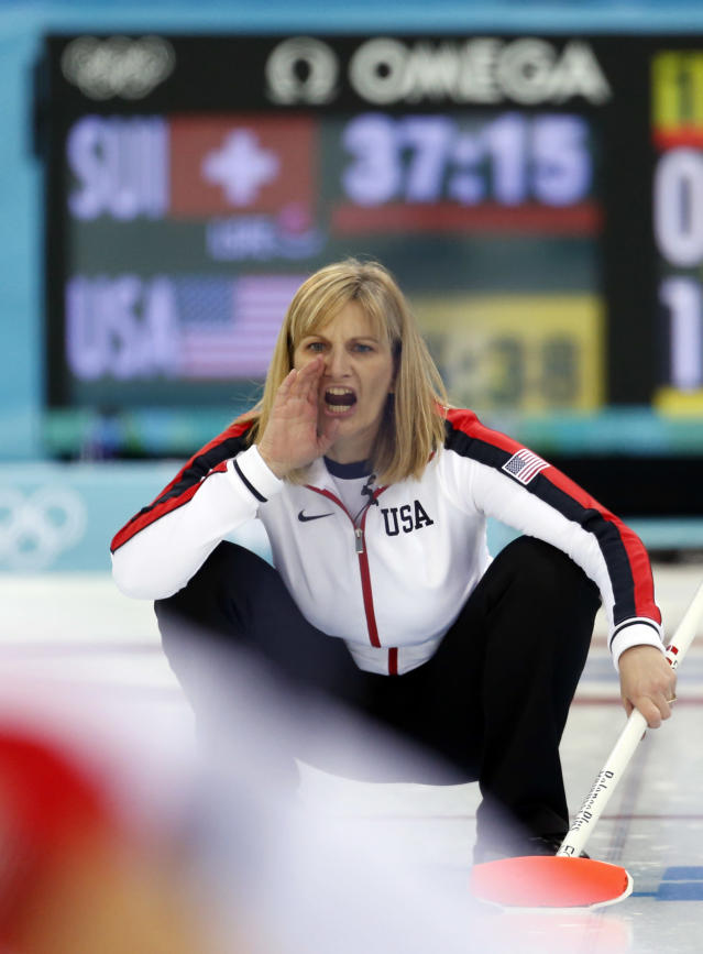 Team USA's skip Erika Brown shouts instructions to her teammates after delivering the rock during women's curling competition against Switzerland at the 2014 Winter Olympics, Monday, Feb. 10, 2014, in Sochi, Russia. (AP Photo/Robert F. Bukaty)