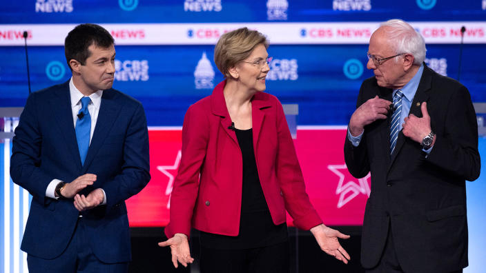 Pete Buttigieg, Sen. Elizabeth Warren and Sen. Bernie Sanders arrive onstage ahead of the tenth Democratic primary debate of the 2020 presidential campaign season co-hosted by CBS News and the Congressional Black Caucus Institute at the Gaillard Center in Charleston, South Carolina, on February 25, 2020. (Jim Watson/AFP via Getty Images)