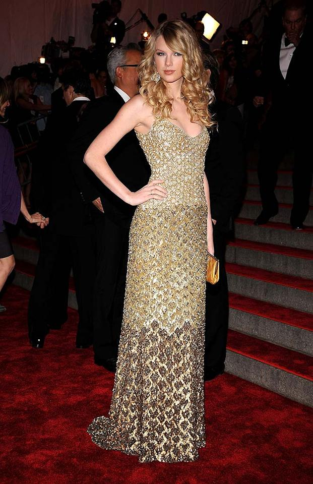 "Country cutie Taylor Swift traded her jeans and cowboy boots for this gorgeous gold fishtail frock courtesy of Badgley Mischka. Dimitrios Kambouris/<a href=""http://www.wireimage.com"" target=""new"">WireImage.com</a> - May 5, 2008"