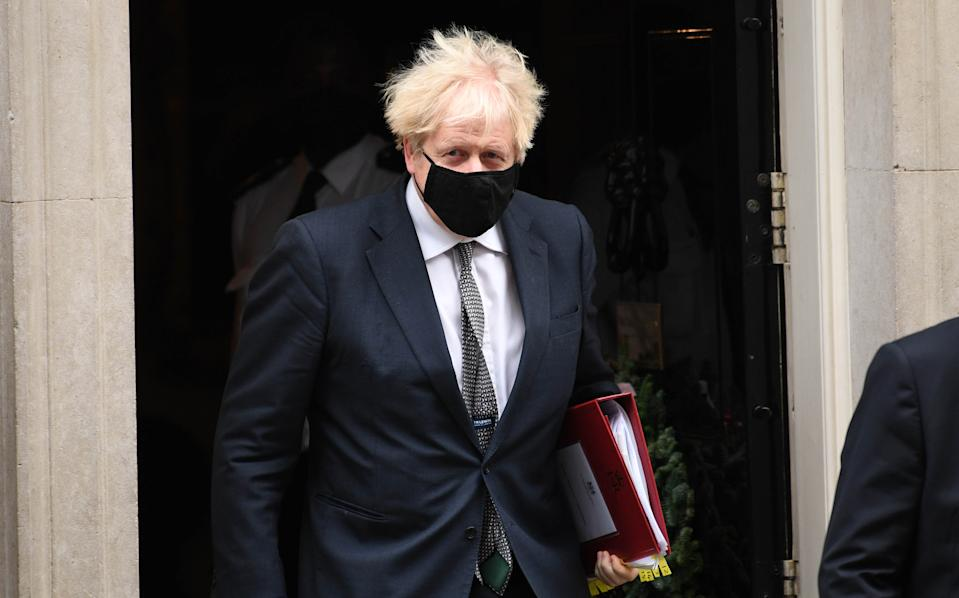 Prime Minister Boris Johnson leaves 10 Downing Street to attend Prime Minister's Questions at the Houses of Parliament, London.
