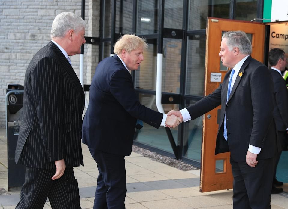 Byron Davies (left) with Prime Minister Boris Johnson shaking hands with Simon Baynes as he arrives at the Welsh Conservative Party Conference in the Llangollen Pavilion in north Wales. (Photo by Peter Byrne/PA Images via Getty Images)