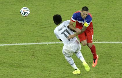 Clint Dempsey (right) wasn't worried about colliding with Sulley Muntari. (AP)