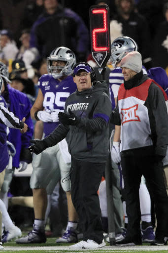 Kansas State head coach Chris Klieman, center, works the sideline during the first half of an NCAA college football game against Iowa State in Manhattan, Kan., Saturday, Nov. 30, 2019. (AP Photo/Orlin Wagner)