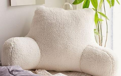 Urban Outfitters Shearling Boo Pillow - Credit: Urban Outfitters