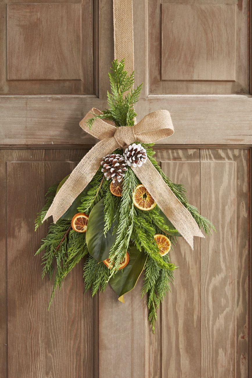 """<p>The Christmas-ready pairing of dried oranges, greenery, and burlap ribbon will be a welcome addition to any window (or door!). After all, when it comes to DIY window decorations, you want to be sure you can still see out the window—which is why the slim profile of this wreath works well. </p><p><a class=""""link rapid-noclick-resp"""" href=""""https://www.amazon.com/BlueHenry-Dehydrated-Orange-30-slices/dp/B083RX2D2Y/?tag=syn-yahoo-20&ascsubtag=%5Bartid%7C10050.g.23343056%5Bsrc%7Cyahoo-us"""" rel=""""nofollow noopener"""" target=""""_blank"""" data-ylk=""""slk:SHOP DRIED CITRUS"""">SHOP DRIED CITRUS</a> </p>"""