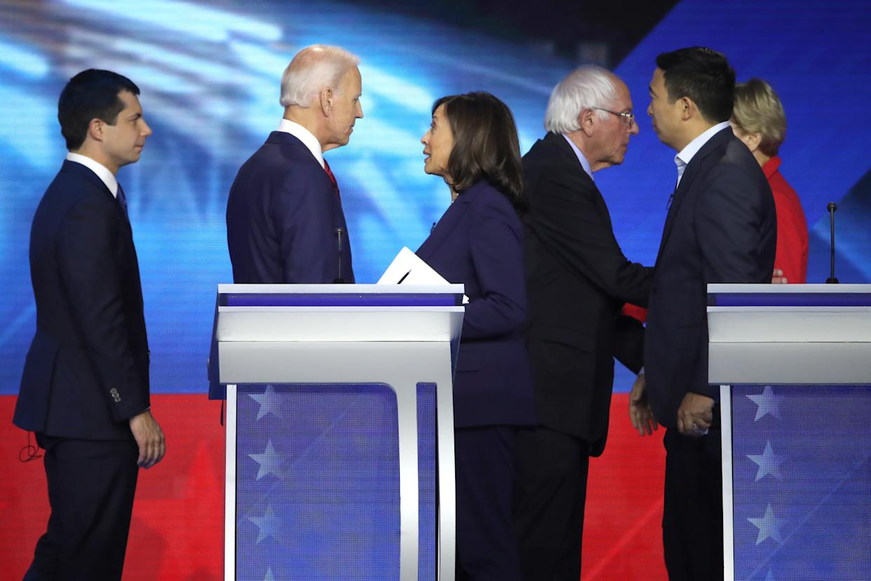 Democratic presidential candidates South Bend, Indiana Mayor Pete Buttigieg, former Vice President Joe Biden, Sen. Kamala Harris (D-CA), Sen. Bernie Sanders (I-VT), former tech executive Andrew Yang, and Sen. Elizabeth Warren (D-MA) interact after the Democratic Presidential Debate at Texas Southern University's Health and PE Center on Sept. 12, 2019 in Houston, Texas. Ten Democratic presidential hopefuls were chosen from the larger field of candidates to participate in the debate hosted by ABC News in partnership with Univision.